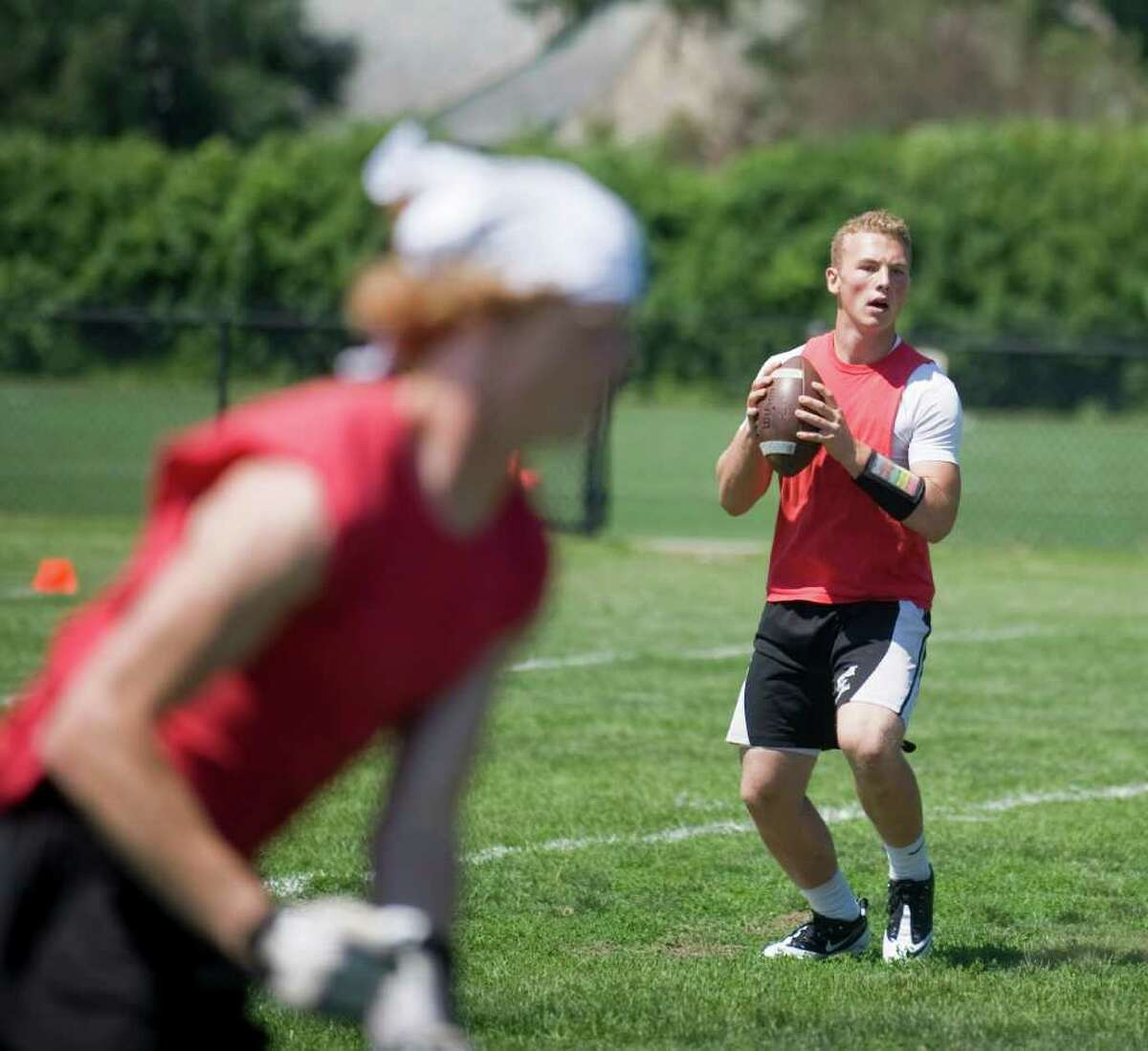 Masuk quarterback Casey Cochran looks to pass against Greenwich during the 3rd Annual Fairfield County 7 on 7