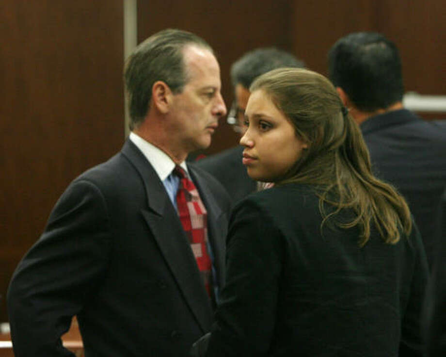 Defense attorney Brian Wice stands with Ashley Benton on Thursday during her trial at the Harris County Criminal Courthouse. Benton is accused of killing Gabriel Granillo in an afternoon gang fight between MS-13 and the Montrose-area gang Crazy Crew at Ervan Chew Park on June 6, 2006. Photo: Billy Smith II, CHRONICLE