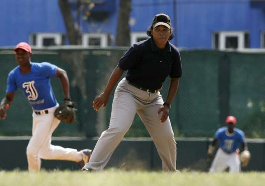 Yanet Moreno, who called 90 games last season in Cuba's top league, is leading the way for the nation's female umpires. Photo: JAVIER GALEANO, ASSOCIATED PRESS