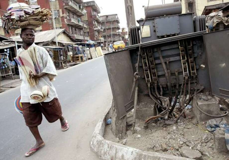 A broken electricity transformer sits in Lagos, Nigeria. Despite living in the oil-rich nation, most can't provide their own power. Photo: SUNDAY ALAMBA, ASSOCIATED PRESS