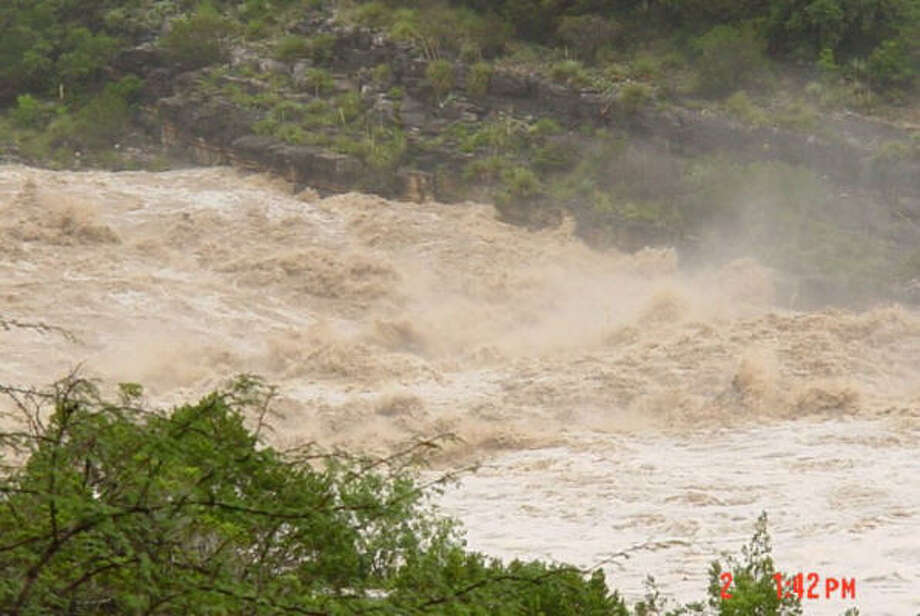 The Pederales River, shown recently, is raging at more than 20 feet above its capacity. Photo: Texas Parks And Wildlife