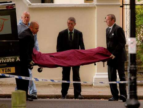 A body, believed to be that of singer Amy Winehouse, is removed from her home following her death, in north London, Saturday, July 23, 2011. Amy Winehouse, the beehived soul-jazz diva whose self-destructive habits overshadowed a distinctive musical talent, was found dead Saturday, July 23, 2011 in her London home, police said. She was 27.(AP Photo/Joel Ryan) Photo: Joel Ryan, STF / AP