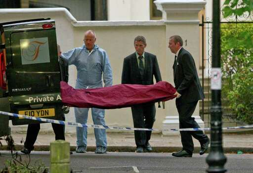 A body, believed to be that of singer singer Amy Winehouse, is removed from her home following her death, in north London, Saturday, July 23, 2011. Amy Winehouse, the soul-jazz diva whose self-destructive habits overshadowed a distinctive musical talent, was found dead Saturday, July 23, 2011 in her London home, police said. She was 27.(AP Photo/Joel Ryan) Photo: Joel Ryan, STF / AP
