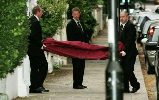 A body, believed to be that of singer singer Amy Winehouse, is removed from her home following her death, in north London, Saturday, July 23, 2011. Amy Winehouse, the soul-jazz diva whose self-destructive habits overshadowed a distinctive musical talent, was found dead Saturday, July 23, 2011 in her London home, police said. She was 27. (AP Photo/PA, Yui Mok) UNITED KINGDOM OUT, NO SALES, NO ARCHIVE Photo: Yui Mok, SUB / PA