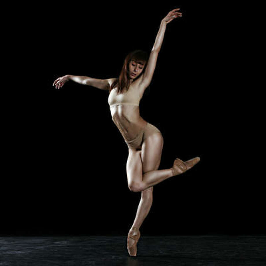 Céline Cassone, a principal dancer with Ballet du Grand Théâtre de Genéve, performs in Annabelle Lopez Ochoa's La Pluie. Photo: GTG / Gregory Batardon