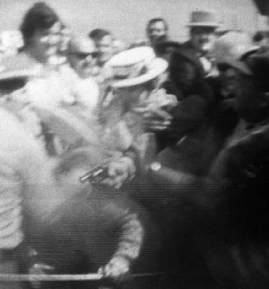 A TV camera shows busboy Arthur Bremer, upper right, shooting Alabama's governor and three other people in 1972. Photo: LAURENS PIERCE, CBS