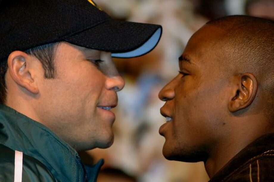 Oscar De La Hoya, left, and Floyd Mayweather Jr. get in each other's face during a news conference Wednesday at the MGM Grand in Las Vegas. De La Hoya will defend his WBC super welterweight title against Mayweather on Saturday. Photo: Brian Jones, AP