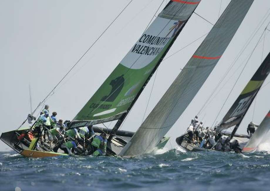 Desafio Espanol, from Spain, left, is unable to hold off Victory Challenge during Louis Vuitton Cup action on Monday. Photo: FERNANDO BUSTAMANTE, ASSOCIATED PRESS