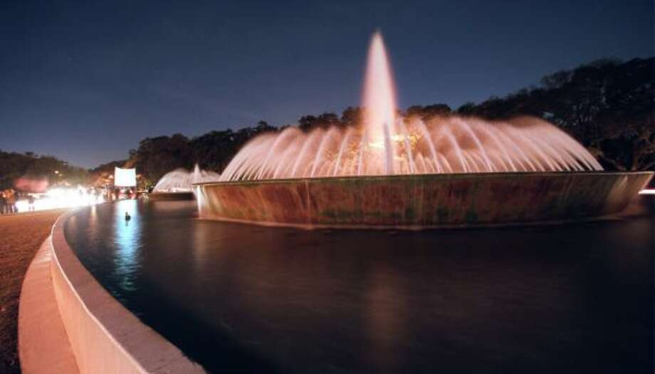 Mecom Fountain, shown in 2003, had its 264 lights stolen. Officials estimate it will cost $100,000 to replace them. Photo: Andrew Innerarity, CHRONICLE FILE