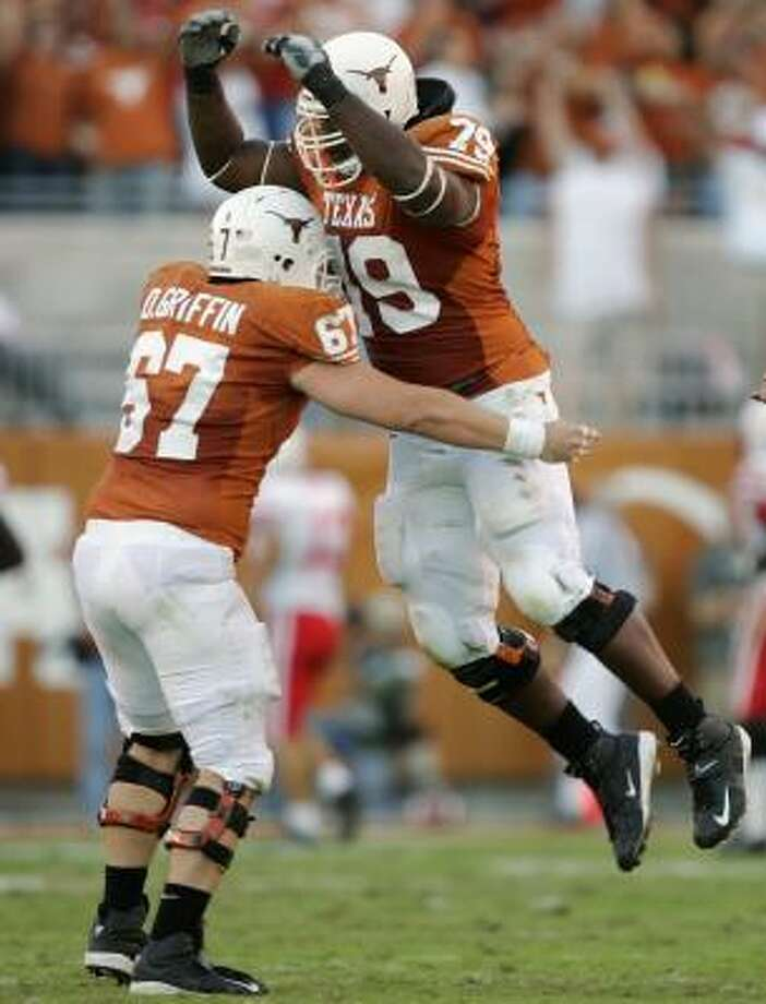 Dallas Griffin, left, and Tony Hills were excited about Jamaal Charles' 86-yard touchdown run after helping pave the way for the game-turning play in Texas' 28-25 win over Nebraska. That come-from-behind victory brought the Longhorns to 7-2 and within reach of attractive bowl destinations. Photo: BRIAN BAHR, GETTY IMAGES