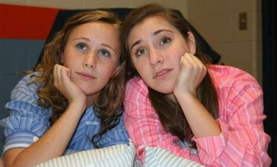 Seven Lakes High School students Julia Rucker and Caroline Badalamenti play sisters Ruth and Eileen, respectively, in ``Wonderful Town.'' Photo: Handout