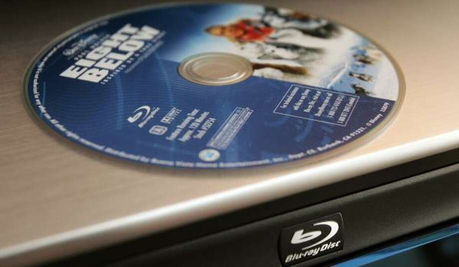 Warner Bros. Entertainment will only release Blu-ray versions of high-definition DVDs, like the Eight Below movie, above. Photo: Reed Saxon, ASSOCIATED PRESS FILE