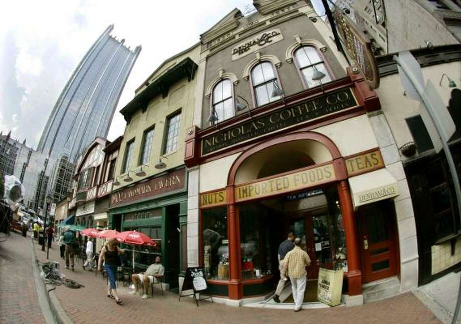 Shops line Pittsburgh's Market Square. Organizers of the city's 250th-anniversary celebration are trying to change the perception of the former steel town. Photo: KEITH SRAKOCIC, ASSOCIATED PRESS