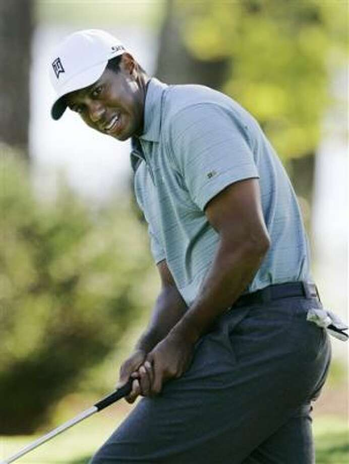 There weren't too many of these anxious moments for Tiger Woods as he followed his 63 with a 64. Photo: Rob Carr, AP