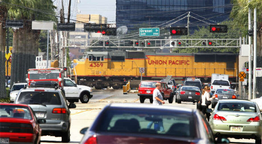 The Union Pacific tracks across Westheimer near Mid Lane and Highland Village are among the railroad crossings in the Houston area that TxDOT has studied as sites for overpasses or closings to reduce traffic delay and improve safety. Photo: Steve Ueckert, Chronicle