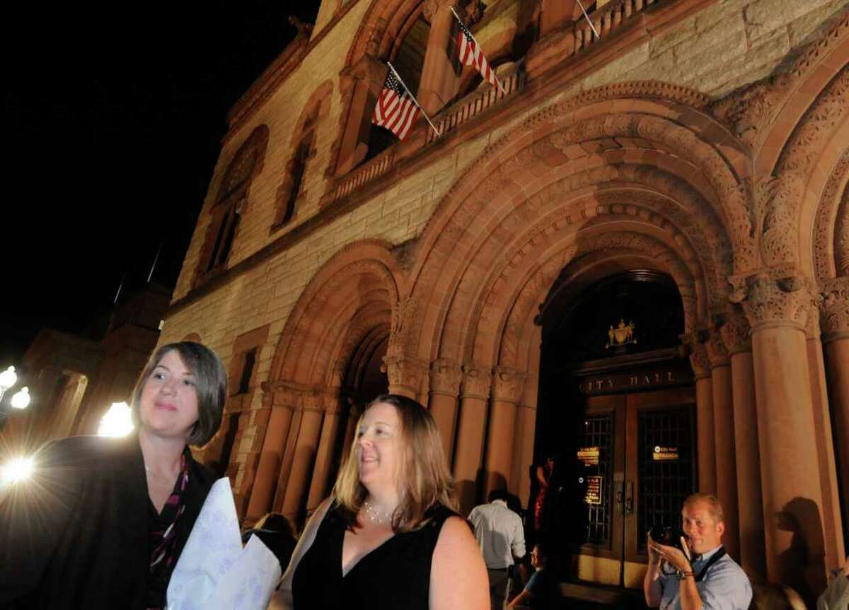 Same-sex couple Joanne Trinkle,left, and Beth Relyea wait ouside of Albany City Hall to be married by Mayor Jerry Jennings at midnight in Albany, NY Saturday July 23,2011.( Michael P. Farrell/Times Union)