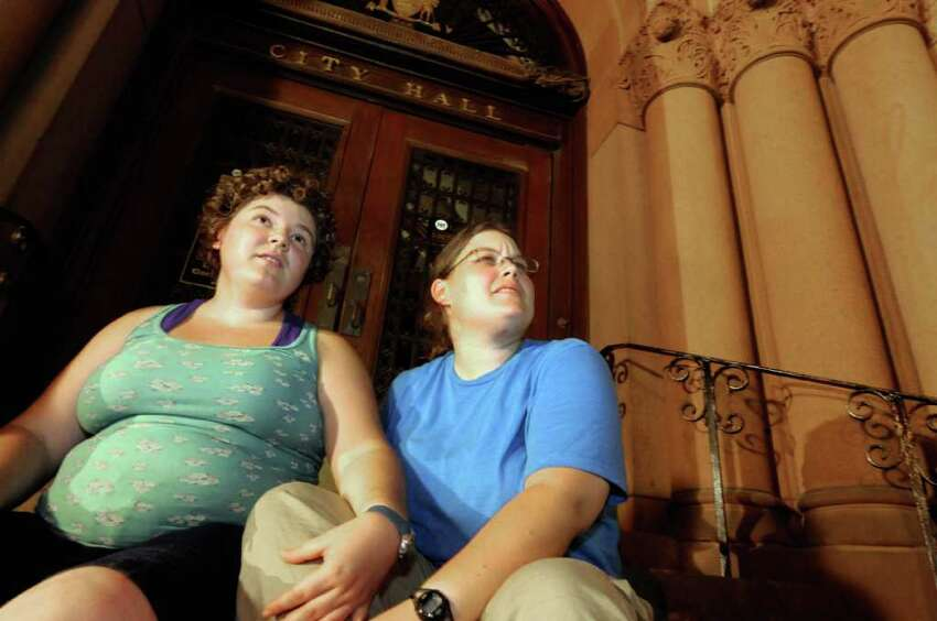 Same-sex couple April Heintze,left, and Kerry Doutrich of Boulder, Colorado wait ouside of Albany City Hall to appy for a marriage licence in Albany, NY Saturday July 23,2011.( Michael P. Farrell/Times Union)