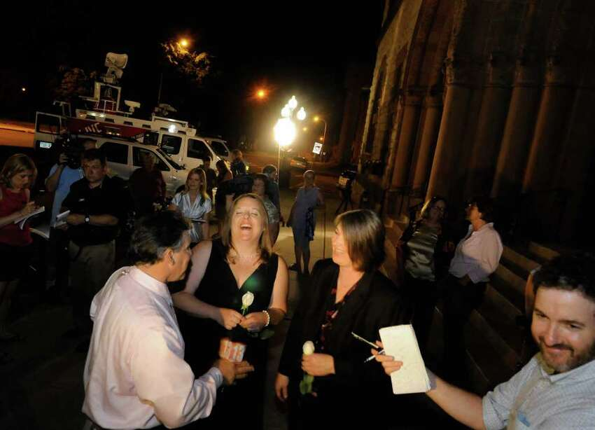 Same-sex couple Beth Relyea and Joanne Trinkle are interviewed by local media as they wait ouside of Albany City Hall to be married by Mayor Jerry Jennings at midnite in Albany, NY Saturday July 23,2011.( Michael P. Farrell/Times Union)