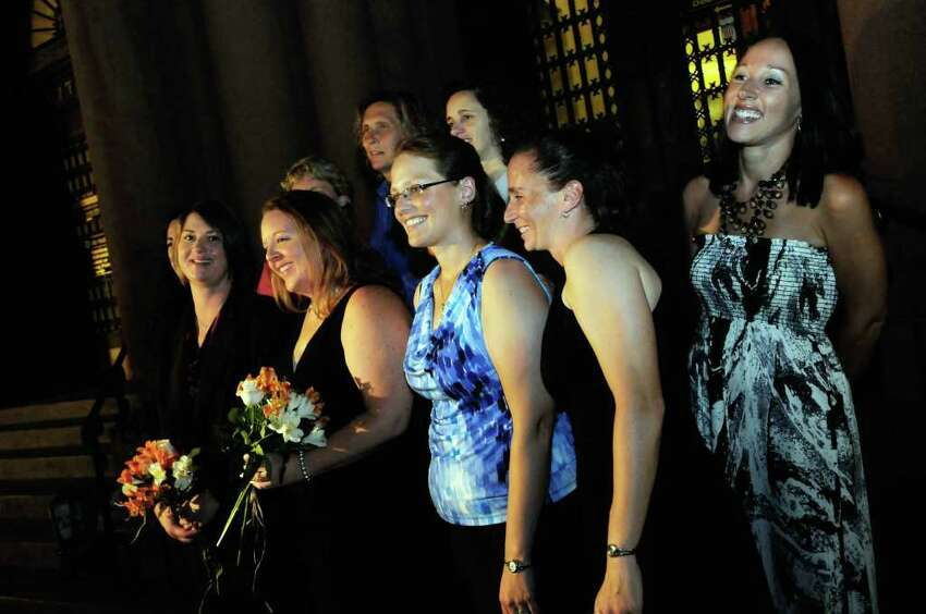Same-sex couple Joanne Trinkle,and Beth Relyea,left, are photographed with friends as they wait ouside of Albany City Hall to be married by Mayor Jerry Jennings at midnite in Albany, NY Saturday July 23,2011.( Michael P. Farrell/Times Union)