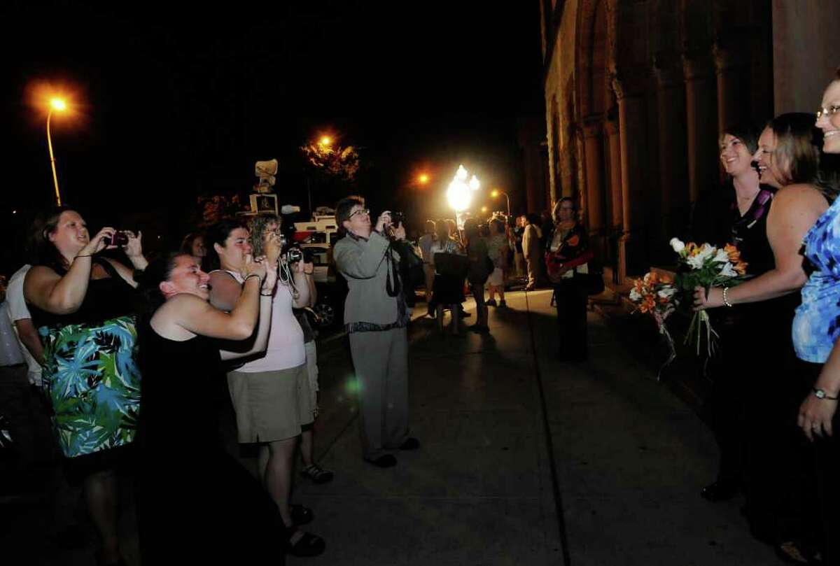 Same-sex couple Joanne Trinkle,and Beth Relyea,right, are photographed with friends as they wait ouside of Albany City Hall to be married by Mayor Jerry Jennings at midnite in Albany, NY Saturday July 23,2011.( Michael P. Farrell/Times Union)
