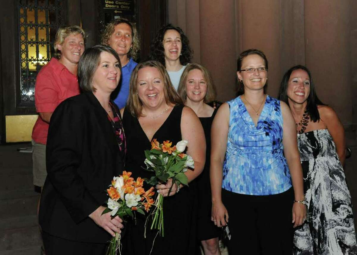 Joanne Trinkle, front left and Beth Relyea, front second from left get a photo taken with their friends before they enter City Hall in Albany, N.Y. on Saturday, July 23, 2011. The couple will be one of the first same-sex couples to marry in NYS. (Lori Van Buren / Times Union)