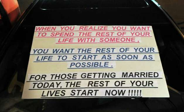 A sign on a car for support of a few of the first same-sex couples to be married in NYS at City Hall in Albany, N.Y. on Saturday, July 23, 2011.  (Lori Van Buren / Times Union) Photo: Lori Van Buren