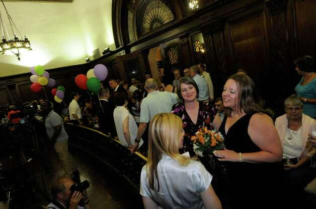 Same-sex couple  Joanne Trinkle,left, and Beth Relyea wait in the city council chamber of Albany City Hall to be married by Mayor Jerry Jennings at midnite in Albany, NY Saturday July 23,2011.( Michael P. Farrell/Times Union) Photo: Michael P. Farrell