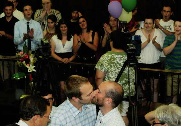 Jon Zehnder,left, and Brian Banks kiss after being married by Judge Joseph C. Teresi at City Hall in Albany, NY Saturday July 23,2011.( Michael P. Farrell/Times Union) Photo: Michael P. Farrell
