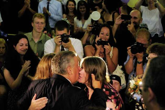 Same-sex couple Beth Relyea and Joanne Trinkle get a kiss after from Mayor Jerry Jennings after he married them at City Hall in Albany, NY Saturday July 23,2011.( Michael P. Farrell/Times Union) Photo: Michael P. Farrell