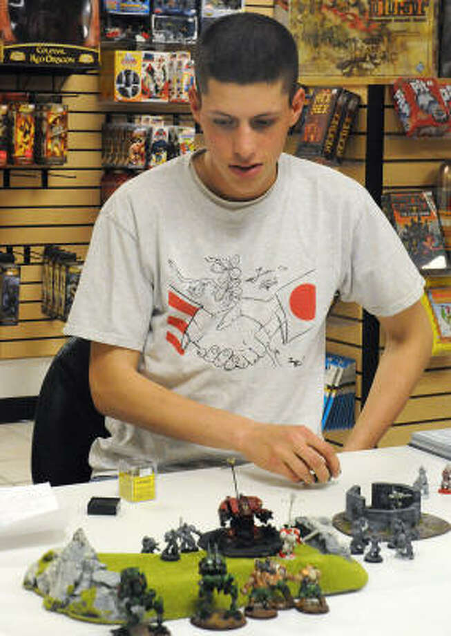 Andrew Bowers, The Woodlands, contemplates his next move during the Warhammer game competition at Fat Ogre Games and Comics, 1440 Sawdust Rd. Suite E2, in The Woodlands. Photo: David Hopper, For The Chronicle