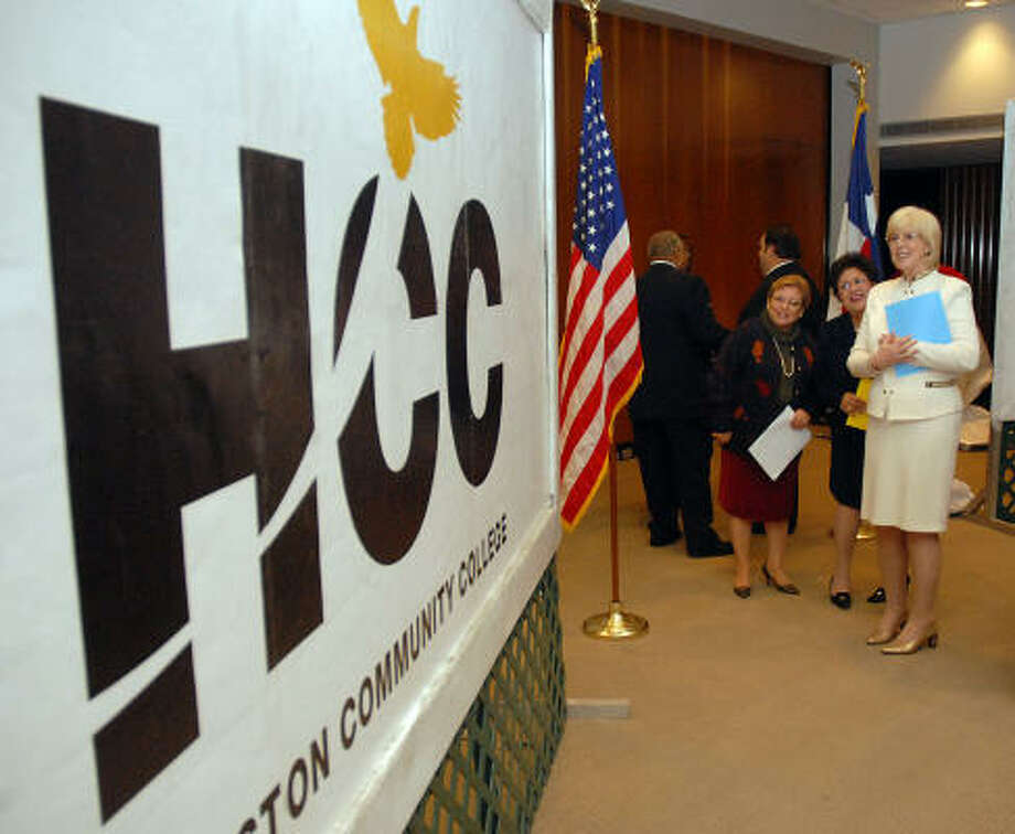 HCC Board of Trustees Secretary Diane Olmos Guzman, left, Vice-Chairwoman Yolanda Navarro Flores and Chancellor Mary S. Spangler admire the new college logo on Wednesday. Colleges are turning to advertising agencies to retool their logos and develop multimedia campaigns. Photo: Dave Rossman, For The Chronicle