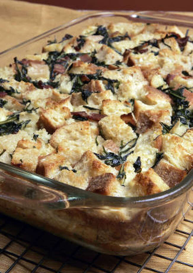 SATISFYING MEAL:Wilted dandelion greens and crisp bacon add texture to this bread pudding. Photo: CARLOS CHAVEZ, Los Angeles Times
