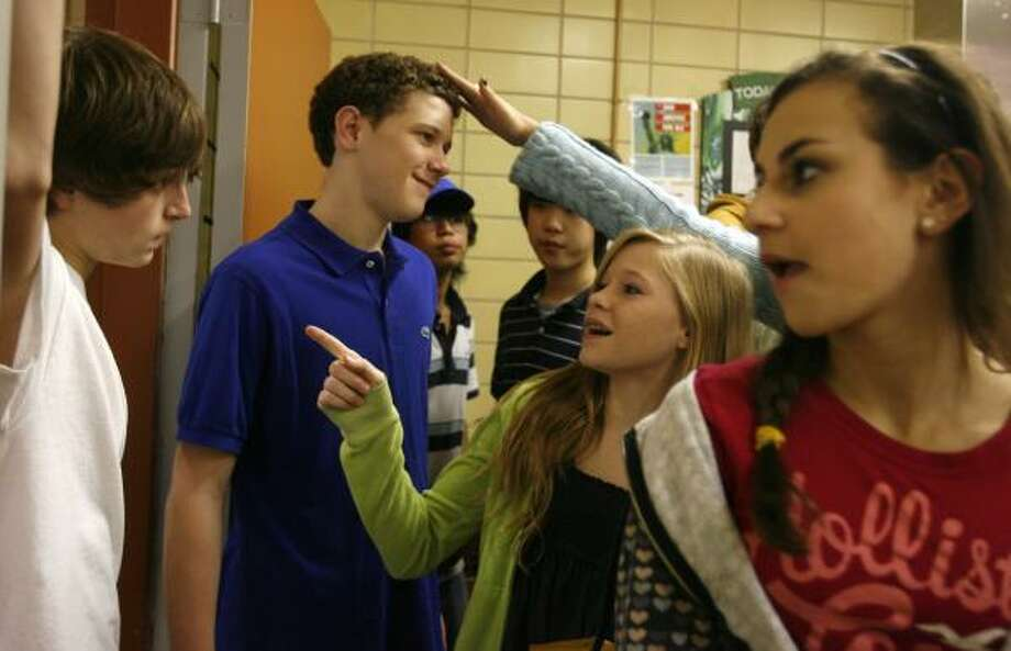 Courtney Guest, second from right, and her friend, Michelle Poretsky, right, both 13, talk with Jared Brown, left, and Garrett Randle, both 14, during No Place for Hate Week at Memorial Middle School. The effort is part of a plan by educators to tackle bullying in schools. Photo: SHARÓN STEINMANN, CHRONICLE