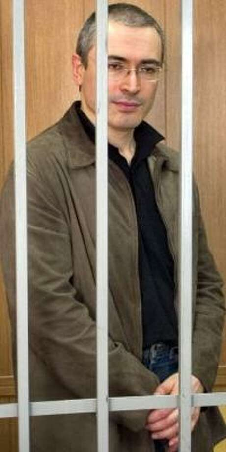Former oil baron Mikhail Khodorkovsky, in a defendant's cage during his 2004 trial, has been charged with money laundering. Photo: MIKHAIL METZEL, ASSOCIATED PRESS FILE
