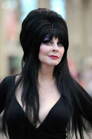 Elvira, Mistress of the Dark, poses at Comic-Con 2011 on July 23, 2011, in San Diego, Calif. Photo: Frazer Harrison, Getty Images / 2011 Getty Images