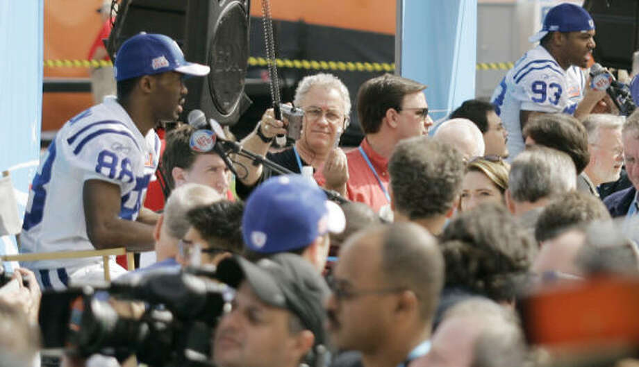 Colts receiver Marvin Harrison (88) and defensive end Dwight Freeney (93) spent an hour talking to hundreds of reporters. Photo: Wilfredo Lee, AP