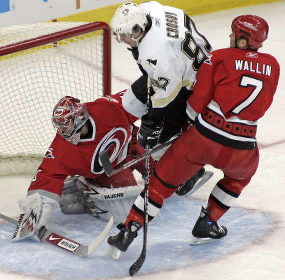 Sidney Crosby crashes the net at Carolina. Photo: Karl B. DeBlaker, AP