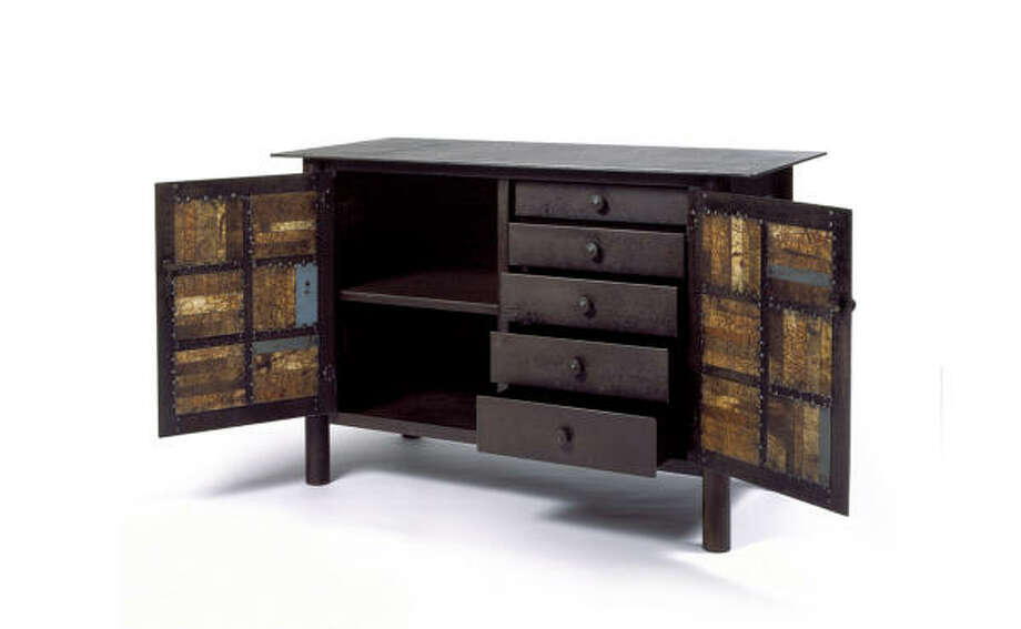 Quilt Cupboard, by Jim Rose, is crafted of steel with natural rust patina and paint. Photo: Tom Van Eynde