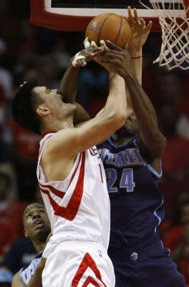 Yao Ming draws a foul from Paul Millsap. Yao finished with 35 points, 16 rebounds and four blocks. Photo: Melissa Phillip, Chronicle