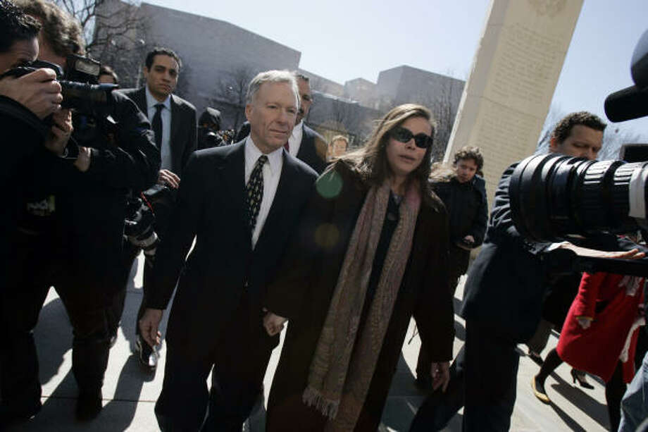 """Former White House aide I. Lewis """"Scooter"""" Libby, left, and his wife, Harriet Grant, leave federal court in Washington Tuesday after the jury reached a guilty verdict in his perjury trial. Photo: Susan Walsh, AP"""
