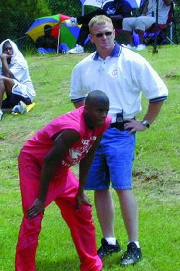 Brian Welch (shown with player Howard Jackson in 2001) is taking over at Brazosport. Photo: Chronicle File