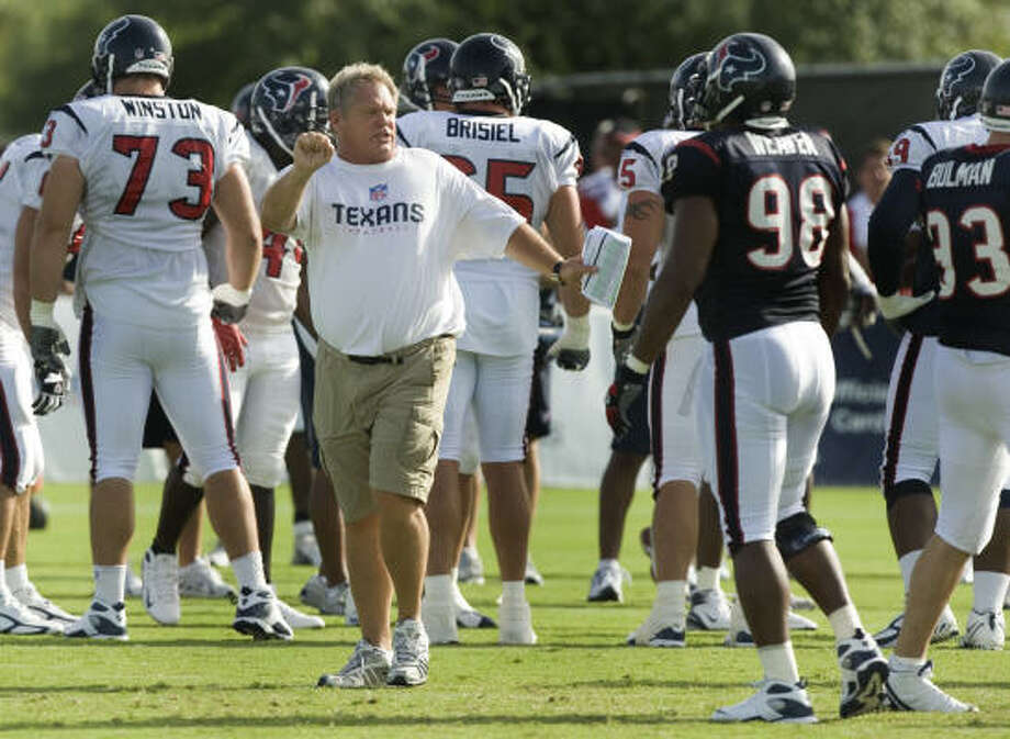 Texans defensive coordinator Richard Smith (center) doesn't have many fans in his corner. Photo: Brett Coomer, Chronicle