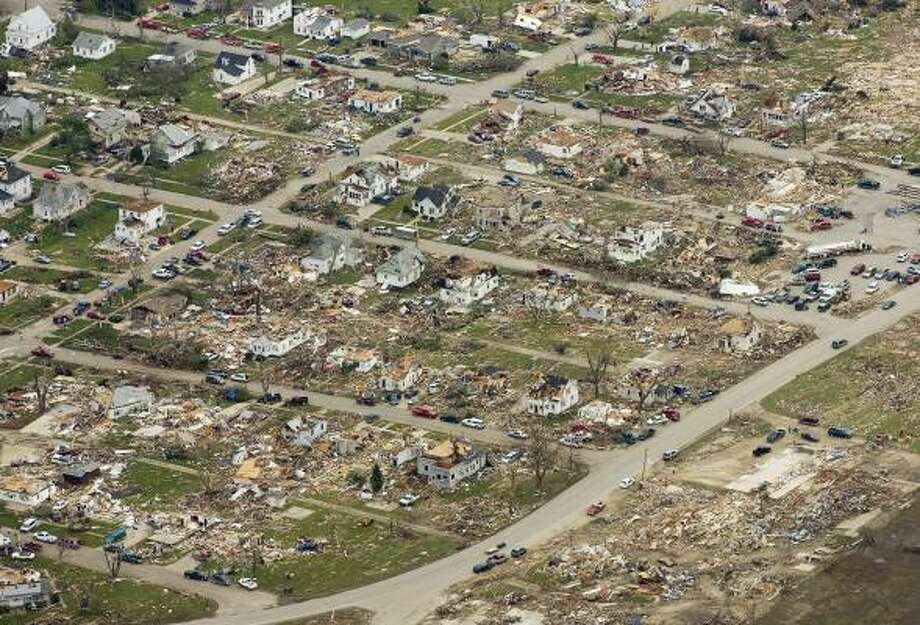 On Monday, the day after the tornado in Parkersburg, Iowa, 222 homes and 21 businesses are destroyed; more than 400 homes are damaged; and the city hall, high school and grocery store are gone. Photo: KEVIN SANDERS, ASSOCIATED PRESS