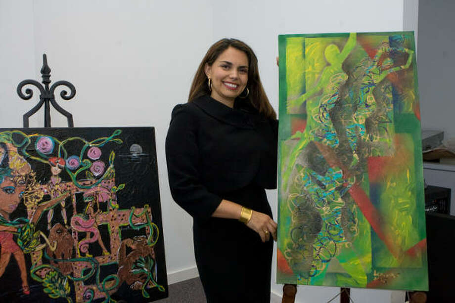 KATY ARTIST: Artist Lorena Fernandez of Katy presents some examples of her work at the Watercolor Art Society of Houston's monthly meeting. Photo: R. Clayton McKee, For The Chronicle
