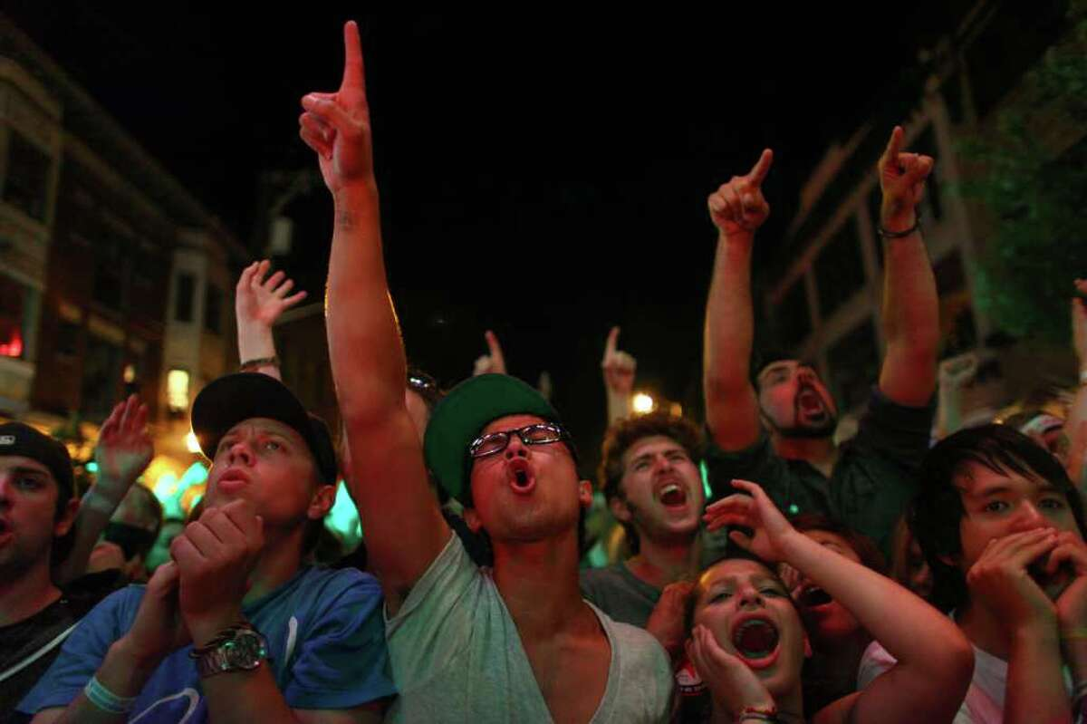 Fans sing along as TV on the Radio performs on the Main stage during day two of the Capitol Hill Block Party.