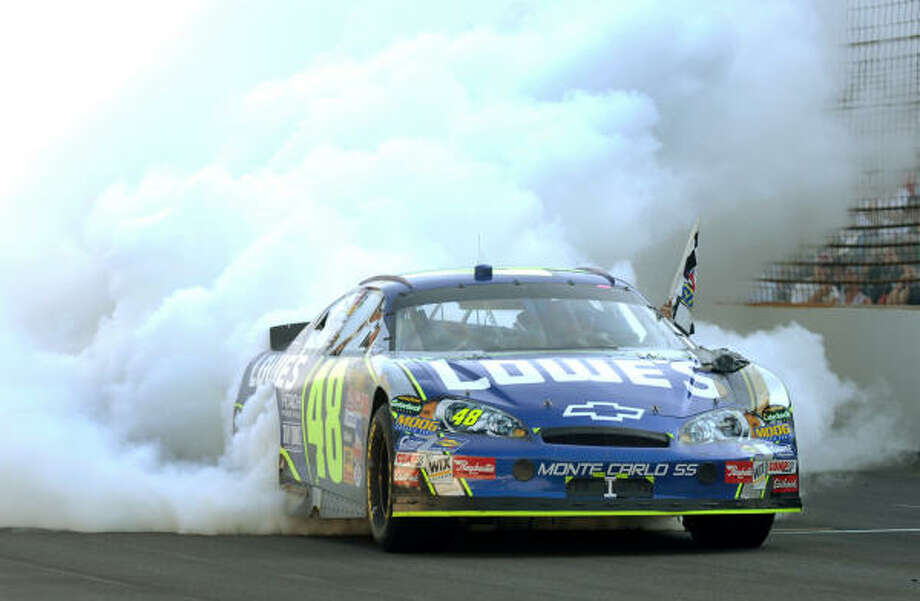 Jimmie Johnson's tires were no longer a concern after winning the Brickyard 400 Sunday in Indianapolis. Photo: TOM STRICKLAND, AP