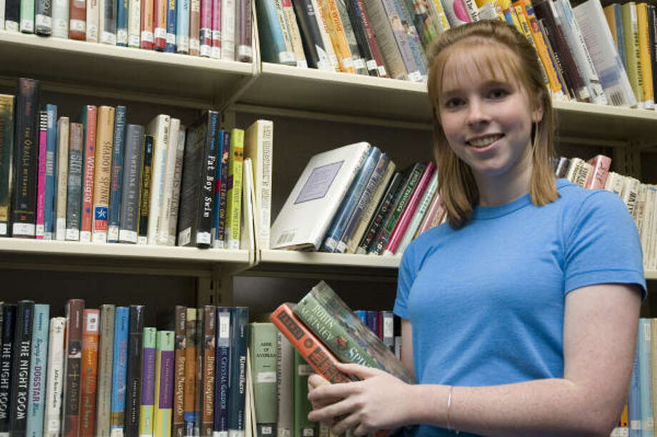 Bellaire High School senior Diana Batten is working to earn the Girl Scout Gold Award by upgrading the young adult section of the Bellaire Public Library. Photo: Debbie Medrano, For The Chronicle