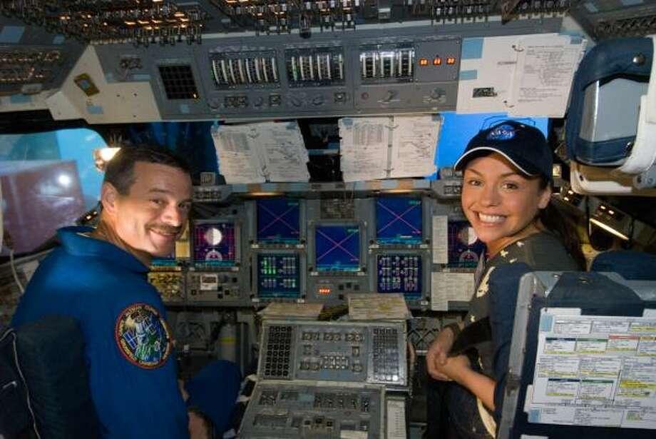 Astronaut Scott Altman gives Rachael Ray a taste of the shuttle flight simulator. Photo: Gregory Smith