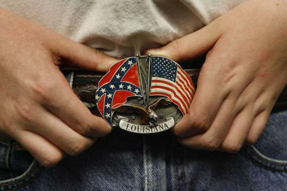 Marshall Alexander said he was told his belt buckle with the American flag and the Confederate battle flag — which he says honors his ancestors — violates his school dress code. But he and a friend are leading a petition drive to get the Alvin district to change its policy. Photo: Carlos Antonio Rios, Chronicle