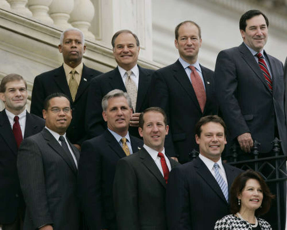 Rep. Nick Lampson, second from top left, joins other newly elected members of the House for a group photo Tuesday.